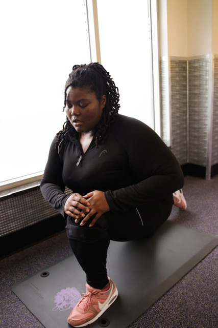Plus-size model Anna Daniel working out.
